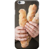 Man holding baguettes iPhone Case/Skin