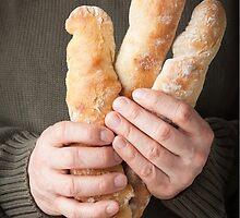 Man holding baguettes by Elisabeth Coelfen