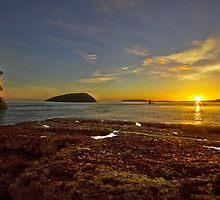 Penmon Lighthouse At Sunrise by Jim Kernan