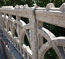 Fragment of an old stone fence of openwork casting by vladromensky