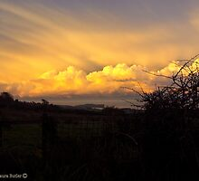 Golden Rays - Late Afternoon Sun on Clouds, County Antrim by Laura Butler