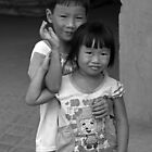 Brother and Sister on the Mekong Delta, Vietnam by Kristi Robertson