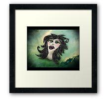 behead Framed Print