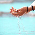 Water through hands by Arve Bettum