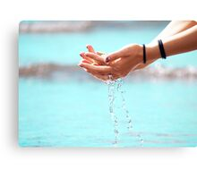 Water through hands Canvas Print