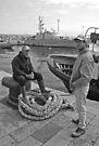 Fishermen on Break - Gallipoli Italy by Debbie Pinard