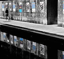 Girl walknig between posters Reflections  by Francesco Malpensi