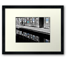 Girl walknig between posters Reflections  Framed Print