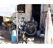 Bike repair man at work, Portugal Photographic Print