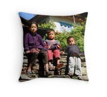 Three Children Sitting on Wall Throw Pillow