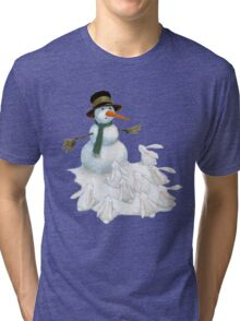 Snowman with Carrot Nose Facing Hungry Bunnies Tri-blend T-Shirt