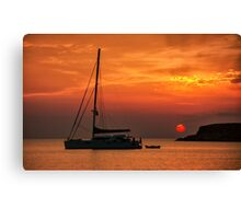 Silhouette of a sailing boat at sunset Canvas Print