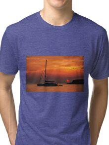 Silhouette of a sailing boat at sunset Tri-blend T-Shirt