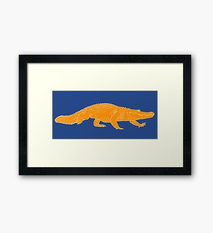 ORANGE gator Framed Print