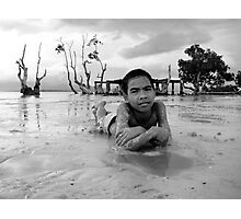 Boy relaxing on the white beach celebrating Christmas Day Photographic Print