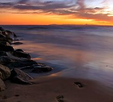 Footsteps in the sand by Doug Dailey