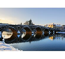 Evening sun shines through the arches of Graiguenamanagh bridge, County Kilkenny, Ireland Photographic Print