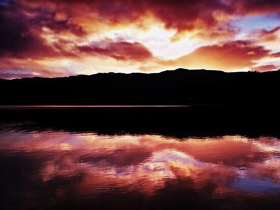 Crimson Clouds Over Loch Achray by Aj Finan
