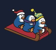 3 winter penguins on a sledge Kids Tee