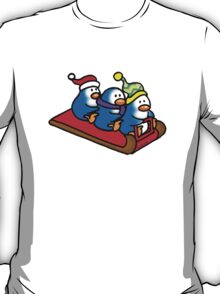 3 winter penguins on a sledge T-Shirt