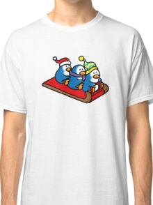 3 winter penguins on a sledge Classic T-Shirt