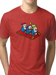 3 winter penguins on a sledge Tri-blend T-Shirt