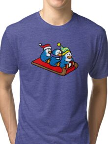 3 winter penguins on a sledge Tri-blend T-Shirt