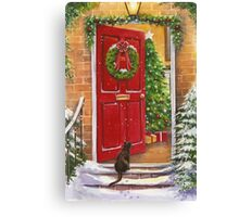 Red front door, decorated for the Holidays. Canvas Print