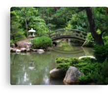 Koi pond with asian wooden bridge Canvas Print