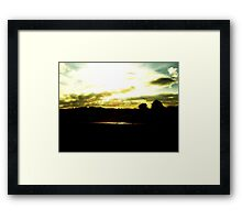 Light shining through the clouds  Framed Print