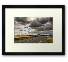 Stormy clouds over Berwick Law Framed Print