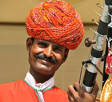 Smiling man in red turban, Rajasthan, India by Catherine Ames