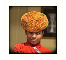 smirking blue-eyed boy in yellow turban, Rajasthan, India Art Print