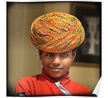 smirking blue-eyed boy in yellow turban, Rajasthan, India Poster
