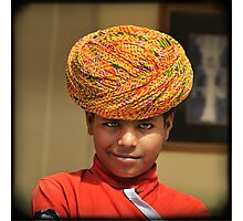 smirking blue-eyed boy in yellow turban, Rajasthan, India Photographic Print