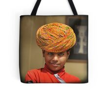 smirking blue-eyed boy in yellow turban, Rajasthan, India Tote Bag