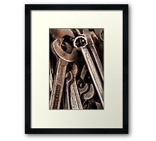 Spanners in the works Framed Print