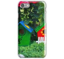 Two small birdhouses in a garden iPhone Case/Skin
