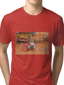 Local woman selling tomatoes on Mombasa Road, KENYA Tri-blend T-Shirt