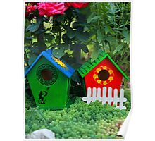 Two small birdhouses in a garden Poster