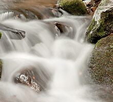 Water flowing over rocks by emvalibe