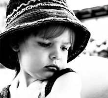 Little Girl Wearing A Hat by Evita