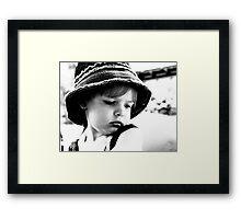 Little Girl Wearing A Hat Framed Print