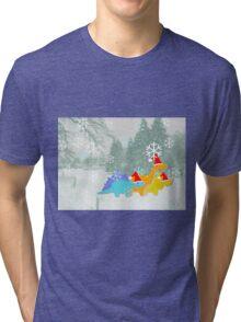 Cute Cartoon Dinosaurs in a Christmas Snow Landscape Tri-blend T-Shirt