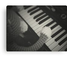 cat playing piano Canvas Print