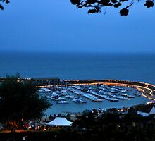 Candles on the Cobb  ,, Lyme Dorset UK by lynn carter