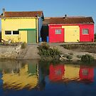 Colourful oyster huts by Carol Dumousseau