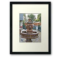 a brass fountain  Framed Print