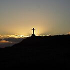 Cross in sunset on Llanddwyn Island by nellie11