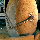 Grain Grinding Wheel. Woolmers Estate, Longford, Tasmania. by Philip Hallam